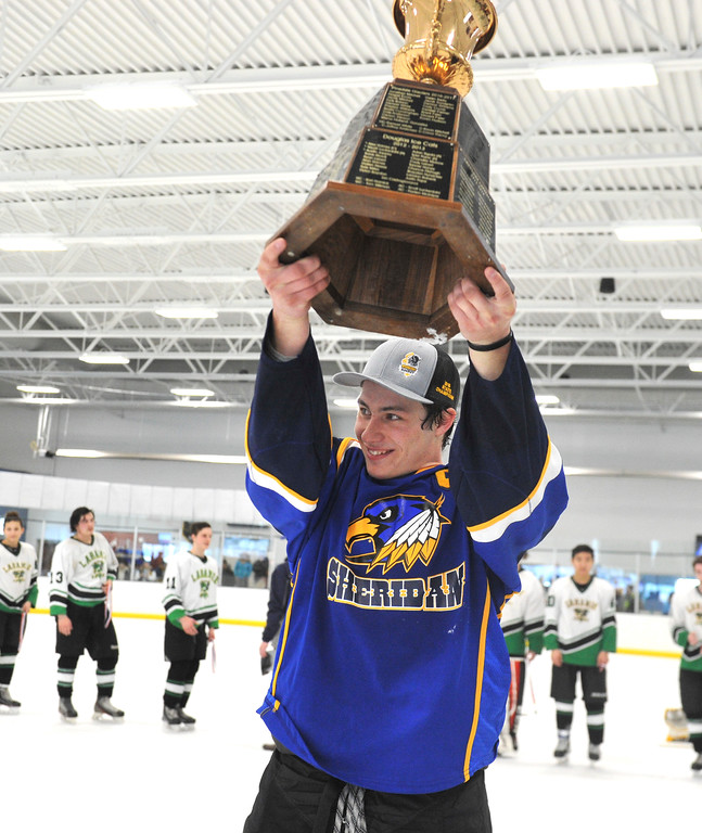Justin Sheely   The Sheridan Press<br /> Hawks captain Samuel Boyles takes up the championship trophy after beating Laramie during the WAHL High School B State Championship at Whitney Ice Rink in the M&M's Center Sunday, Feb. 25, 2018. The Hawks beat Laramie 4-3 to claim their first state title in 12 years.