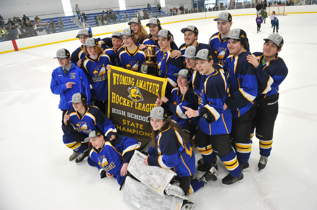 Justin Sheely   The Sheridan Press<br /> The Hawks takes up the championship trophy after beating Laramie during the WAHL High School B State Championship at Whitney Ice Rink in the M&M's Center Sunday, Feb. 25, 2018. The Hawks beat Laramie 4-3 to claim their first state title in 12 years.