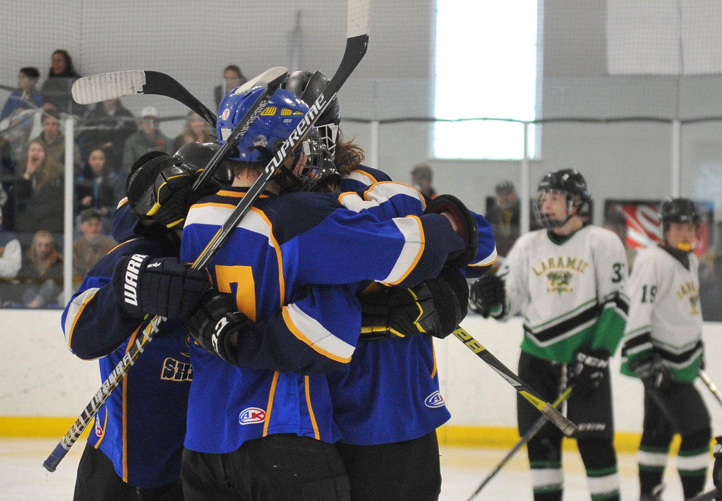 Justin Sheely   The Sheridan Press<br /> Sheridan Hawks celebrate a goal by Winfield Lommis against Laramie during the WAHL High School B State Championship at Whitney Ice Rink in the M&M's Center Sunday, Feb. 25, 2018. The Hawks beat Laramie 4-3 to claim their first state title in 12 years.
