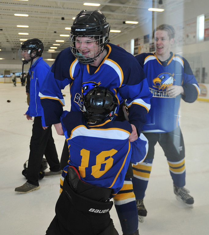 Justin Sheely   The Sheridan Press<br /> Sheridan's Gunnar Swanson, center, and Matthew Hooge celebrate after beating Laramie during the WAHL High School B State Championship at Whitney Ice Rink in the M&M's Center Sunday, Feb. 25, 2018. The Hawks beat Laramie 4-3 to claim their first state title in 12 years.