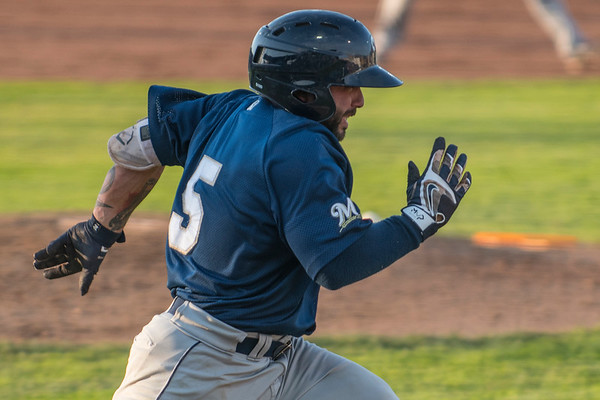 Helena Brewers batter Jose Gomez (5) gets a base hit against the Ogden Raptors at Lindquist Field in Ogden, on Tuesday July 18, 2017.