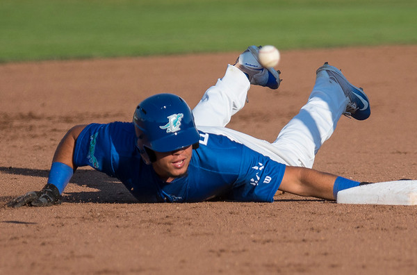 Ogden Raptors player Gersel Pitre (45) slides to second base and is called safe against the Helena Brewers at Lindquist Field in Ogden, on Tuesday July 18, 2017.