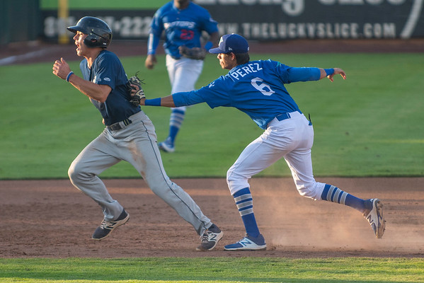 Moises Perez (6) of the Ogden Raptors tags out the Helena Brewers runner Zach Clark (10) after being in the pickle at Lindquist Field in Ogden, on Tuesday July 18, 2017.