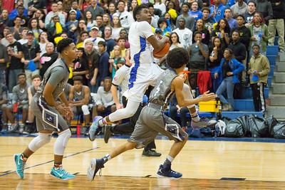 Pflugerville's Greg Schexnayder drives towards the basket against Hendrickson Tuesday at Pflugerville High School.