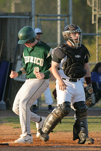 IMG_59948Henrico's Seth Cutler-Voltz scores on a hit by Taylor Smith in the first inning. Despite the promising beginning, it would be the only run Henrico would score.