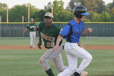 IMG_66547Henrico' Alvin Hence tags out Atlee's Brent Bettinger at first in the bottom of the third.