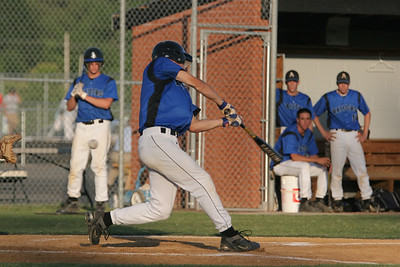 IMG_66399Atlee's Ryan Farrar swings and misses the pitch by Henrico's Eric Thornton.
