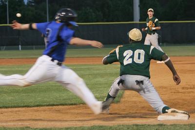 IMG_66728Atlee's Barrett Seay races the throw from shortstop Landon Prentiss to first baseman Alvin Hence.