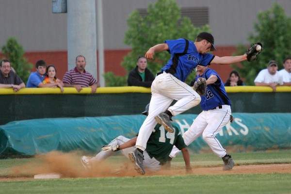 IMG_66655Henrico's Landon Prentiss slides safely into third on a grounder to short by Eric Thornton.