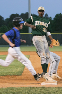 IMG_66720Henrico's Alvin Hence beats Atlee's Brent Bettinger to first to get the out.