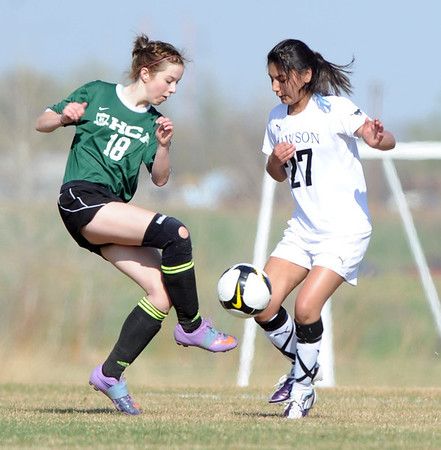 "Devanshi Desai (27) of Alexander Dawson, keeps the ball from Lexy Pouliot (18) of Heritage Christian Academy.<br /> For more photos of the game, go to  <a href=""http://www.dailycamera.com"">http://www.dailycamera.com</a>.<br />  Cliff Grassmick / April 4, 2012"