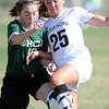 "Emily Oliver (25) of Alexander Dawson, battles with Jamie Darbie (10) of Heritage Christian Academy.<br /> For more photos of the game, go to  <a href=""http://www.dailycamera.com"">http://www.dailycamera.com</a>.<br />  Cliff Grassmick / April 4, 2012"