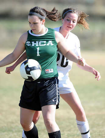 "Mariah Green, left of Hertiage Christian, tries to keep the ball from Kelly Dulin of Dawson.<br />  more photos of the game, go to  <a href=""http://www.dailycamera.com"">http://www.dailycamera.com</a>.<br />  Cliff Grassmick / April 4, 2012"