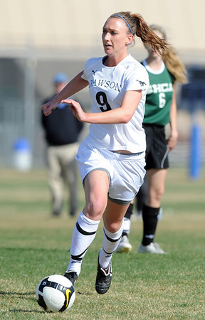 """Annie Sullivan of Alexander Dawson looks to pas against Heritage Christian.<br /> For more photos of the game, go to  <a href=""""http://www.dailycamera.com"""">http://www.dailycamera.com</a>.<br />  Cliff Grassmick / April 4, 2012"""