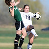 "Emma Clarke (19) of Alexander Dawson, kicks the ball from Taylor Glasgow of Heritage Christian Academy.<br /> For more photos of the game, go to  <a href=""http://www.dailycamera.com"">http://www.dailycamera.com</a>.<br />  Cliff Grassmick / April 4, 2012"