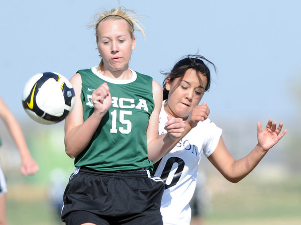 "Alex Parea, right, of Alexander Dawson, tries to get through Samantha Loom of Heritage Christian.<br /> For more photos of the game, go to  <a href=""http://www.dailycamera.com"">http://www.dailycamera.com</a>.<br />  Cliff Grassmick / April 4, 2012"