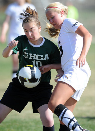 "Emily Oliver (25), right, of Alexander Dawson, battles with Jamie Darbie (10) of Heritage Christian Academy.<br /> For more photos of the game, go to  <a href=""http://www.dailycamera.com"">http://www.dailycamera.com</a>.<br />  Cliff Grassmick / April 4, 2012"