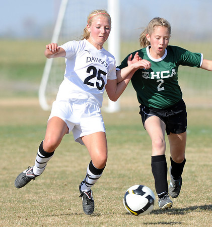 "Emily Oliver, left, of Dawson, battles with Kyla Bruxvoort of Heritage Christian.<br /> For more photos of the game, go to  <a href=""http://www.dailycamera.com"">http://www.dailycamera.com</a>.<br />  Cliff Grassmick / April 4, 2012"