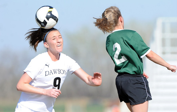 "Annie Sullivan, left, of Alexander Dawson, gets a header past Kyla Bruxvoort of Heritage Christian.<br /> For more photos of the game, go to  <a href=""http://www.dailycamera.com"">http://www.dailycamera.com</a>.<br />  Cliff Grassmick / April 4, 2012"