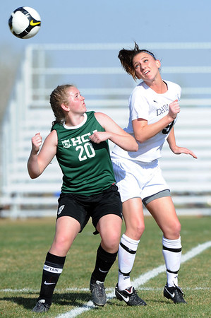"Morgan Lilley, left, of Heritage Christian, and Annie Sullivan of Alexander Dawson, battle for the ball.<br /> For more photos of the game, go to  <a href=""http://www.dailycamera.com"">http://www.dailycamera.com</a>.<br />  Cliff Grassmick / April 4, 2012"