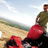 Tim Nowicki, 40, of Elbert, pulls his paraglider from his bag at the top of the ridge just west of the North Boulder Community Park on Tuesday, Sept. 29, 2009. Nowicki was trying to complete his P2 novice rating with the ParaSoft Paragliding School out of Boulder.<br /> Photo by Jeremy Papasso / The Camera / Sept. 29, 2009