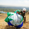 Tim Nowicki, 40, of Elbert, carries his paraglider back up the ridge just west of the North Boulder Community Park on Tuesday, Sept. 29, 2009. <br /> Photo by Jeremy Papasso / The Camera / Sept. 29, 2009<br /> <br /> <br /> Photo by Jeremy Papasso / The Camera / Sept. 29, 2009
