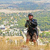 Paul Jerothe, 65, of Boulder, prepares for lift-off with his paraglider at the top of a ridge just west of the North Boulder Community Park on Tuesday, Sept. 29, 2009.<br /> Photo by Jeremy Papasso / The Camera / Sept. 29, 2009