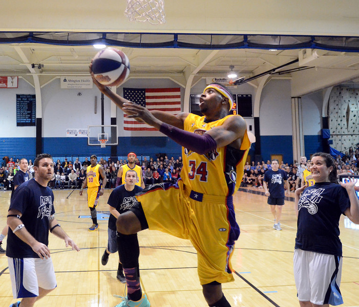 """The Harlem Wizards take on the North Penn School District """"Dream Team"""" as they entertain the huge crowd gathered at North Penn High School for their game to benefit the North Penn Athletics Program on Saturday evening January 25,2014. Photo by Mark C Psoras/The Reporter"""