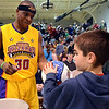 "A young fan gets a ball signed by a member of the Harlem Wizards as they take on the North Penn School District ""Dream Team"" at North Penn High School for their game to benefit the North Penn Athletics Program on Saturday evening January 25,2014. Photo by Mark C Psoras/The Reporter"