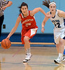 Souderton's Bianca Picard ,25, works a ball past North Penn's  Vicky Tumasz ,22, during first half action of their contest at North Penn High School on Thursday January 15,2014. Photo by Mark C Psoras/The Reporter