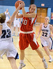 Souderton's Tina Miller ,10, grabs a rebound away from North Penn's  Sam Caraangi ,23, during first half action of their contest at North Penn High School on Thursday January 15,2014. Photo by Mark C Psoras/The Reporter