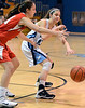 North Penn's Mikeala Giuliana ,13,  puts a pass around  Souderton defender Sarah Derstine ,31,  during first half action of their contest at North Penn High School on Thursday January 15,2014. Photo by Mark C Psoras/The Reporter