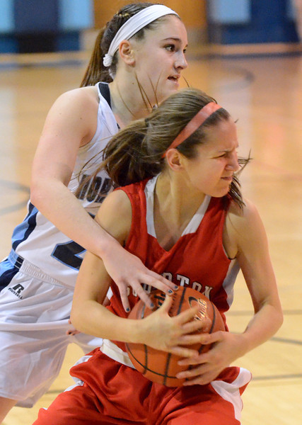 Souderton's Tina Miller ,10, and  North Penn's Vicky tumasz ,22, battle for a rebound during second half action of their contest at North Penn High School on Thursday January 15,2014. Photo by Mark C Psoras/The Reporter