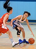 North Penn's Irisa Ye ,11, works a ball around  Souderton defender Bianca Picard ,25 during first half action of their contest at North Penn High School on Thursday January 15,2014. Photo by Mark C Psoras/The Reporter