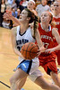 North Penn's Sam Carangi ,23, goes in for a basket past Souderton's Marissa Sandone ,23, during second half action of their contest at North Penn High School on Wednesday January 15,2014. Photo by Mark C Psoras