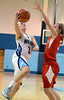 North Penn's Erin Maher ,2, puts in a shot over Souderton' defender Allison Gallagher ,3, during second half action of their contest at North Penn High School on Wednesday January 15,2014. Photo by Mark C Psoras