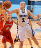 North Penn's Erin Maher ,2, grabs a rebound awy from Souderton's Hannah Bergey ,21, during first half action of their contest at North Penn High School on Wednesday January 15,2014. Photo by Mark C Psoras