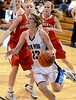 North Penn's Brianna Cullen ,21, goes in for a shot around Souderton defenders  during second half action of their contest at North Penn High School on Thursday  January 15,2014. Photo by Mark C Psoras