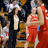 Souderton Head Coach Lynn Carroll shouts instructions to her team during their contest against the Maidens at North Penn High School on Thursday January 15,2014. Photo by Mark C Psoras/The Reporter