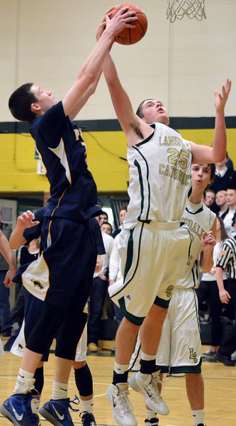 Lansdale Catholic's Brendan Schneider ,25, has a shot denied by Pope JohN Paul II's James McKeon ,13, during second half action of their contest at Lansdale Catholic High School on Wednesday, January 30, 2014.   Photo by Mark C Psoras/The Reporter