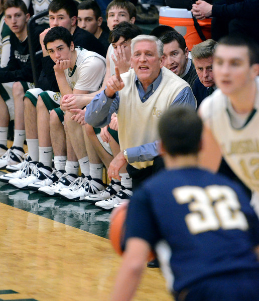 Lansdale Catholic Head Coach Ed Enoch shouts instructions to his team during first half action of their contest against Pope John Paul II at Lansdale Catholic High School on Wednesday, January 30, 2014.   Photo by Mark C Psoras/The Reporter