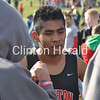 Clinton High School senior Emmanuel Marcos-Teles captured 14th place for the second year in a row at the Iowa Class 4A boys cross country state meet on Saturday, Oct. 27, 2012, in Fort Dodge. Marcos-Teles (bib No. 915) ran the 5,000-meter course in 15 minutes, 47 seconds.  Jason Thomas (bib No. 518) of team champion West Des Moines Dowling Catholic was the individual champion in 15:02, followed by Dylan Eigenberger (bib No. 521) of Dubuque Senior and Caleb Drake (bib No. 563) of Pleasant Valley in 15:07 each. All three times broke the previous course record for 4A boys.  In 4A girls, freshman Stephanie Jenks (bib No. 73) of Marion Linn-Mar was the champion in 13:42. Pleasant Valley won the team title.
