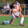 Gwynedd Mercy 's Nicole Catalino ,18, strikes a penalty-shot for a goal against Nazareth Academy during second half action of their contest at Gwynedd Mercy Academy on Wednesday October 2,2013. Photo by Mark C Psoras/The Reporter