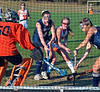 Gwynedd Mercy's Kaitlin McCaulley ,12, scores a goal past Nazareth Academy goalie Colleen Corbett ,50,  and defenders during second half cation of their contest at Gwynedd Mercy Academy on Wednesday October 2,2013. Photo by Mark C Psoras/The Reporter