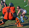 Gwynedd Mercy's Cassie O'Brien,10, scores a goal past Nazareth Academy goalie Colleen Corbett ,50,  and defenders during second half cation of their contest at Gwynedd Mercy Academy on Wednesday October 2,2013. Photo by Mark C Psoras/The Reporter