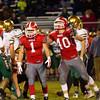 Goshen junior Evan Back (1) celebrates a sack with junior teammate Alex Lehr during the game Friday.