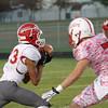 SAM HOUSEHOLDER | THE GOSHEN NEWS<br /> Goshen junior receiver Josuel Sanchez catches the ball with Plymouth defender junior Colten Schuler closing in during the game Friday.