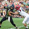 CHAD WEAVER | THE GOSHEN NEWS<br /> Northridge quarterback Matt Miller tries to avoid NorthWood defensive lineman Tyler Thornton during the first quarter of Friday night's game at Northridge.