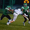 HALEY WARD | THE GOSHEN NEWS <br /> Concord running back Lavontae Wagner blocks Saint Joseph safety Sean Ratigan for wide receiver Cedric Mitchell Friday at Concord High School.