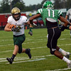 HALEY WARD | THE GOSHEN NEWS <br /> Wawasee Michael Katzer attempts to evade the tackle from Concord defensive back Cedric Mitchell tackles Friday at Concord High School.